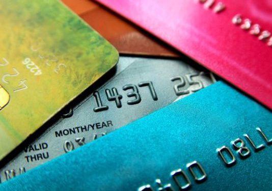 Credit card debt hits new record, raising warning sign